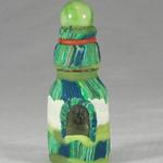 Small green striped bottle with marble top. The bottle and the marble were both found washed up along the beach.