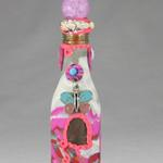 Whimsical beaded Genie bottle with a pink & blue butterfly adorning the front.