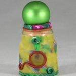Small green and yellow Genie bottle.