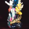 Coral and glass on blue glass vase with polymer clay corals, leopard shark, starfish, crabs and other sculpted crustaceans.